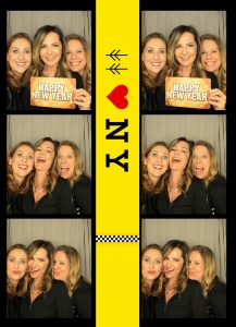 Three women on a photo booth photo
